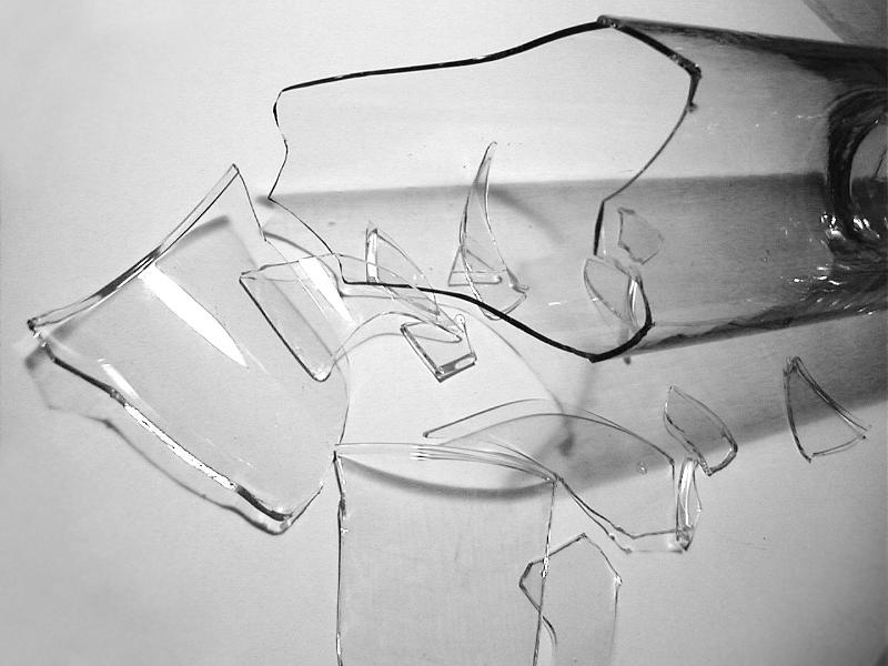 Free image of broken glass bottle pieces over gray for What to do with broken mirror pieces