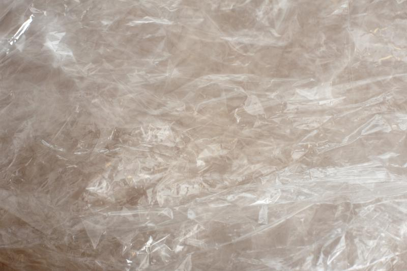Free image of crinkled plastic film background texture