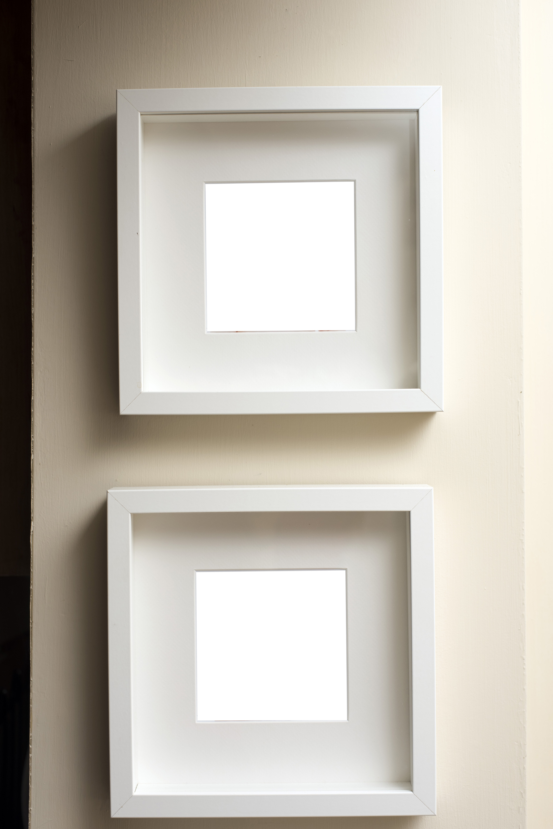 Free image of Two empty square neutral colored frames