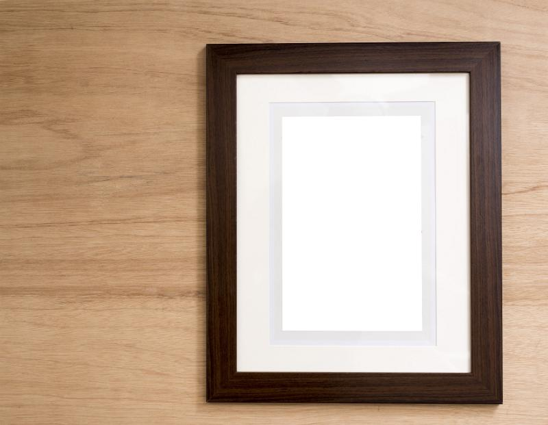 free image of empty frame with mount card hanging on wall. Black Bedroom Furniture Sets. Home Design Ideas