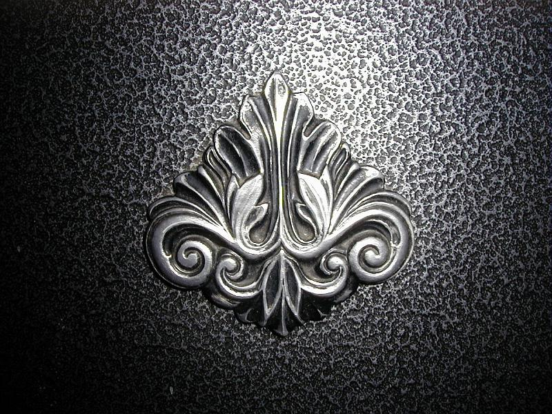 Free image of acanthus leaf decoration on a fireplace for Acanthus leaf decoration