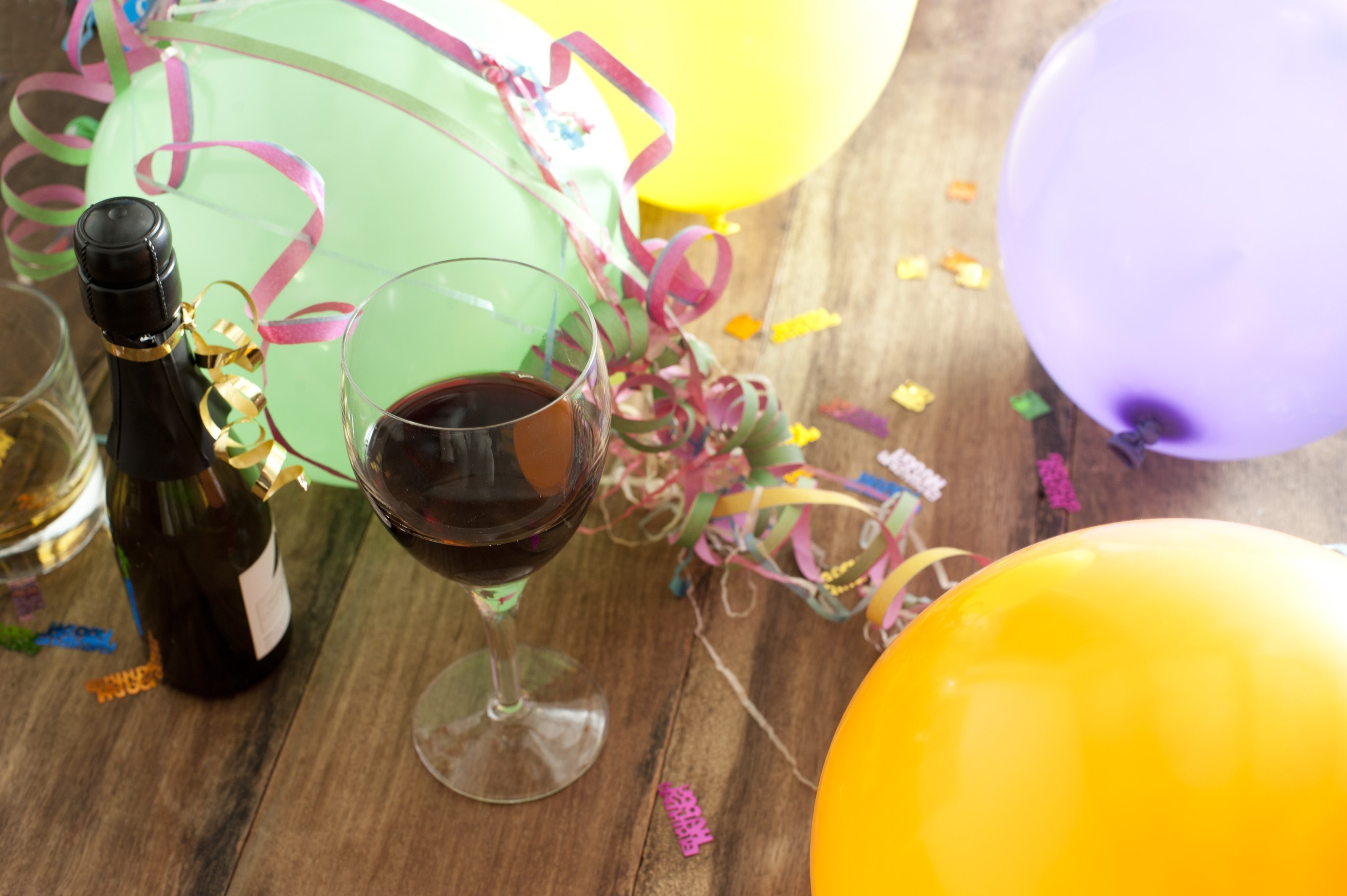 Free Image Of Birthday Decorations With Glass Red Wine
