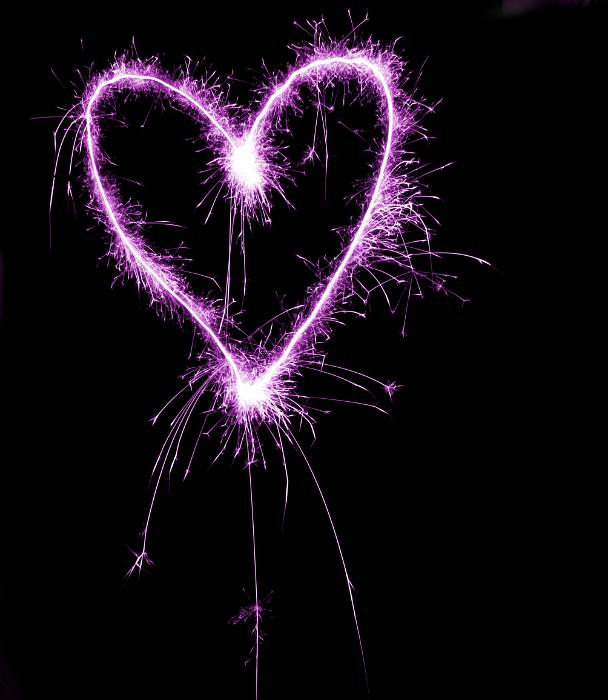 a magenta coloured sparkling love heart valentine theme image on a black background