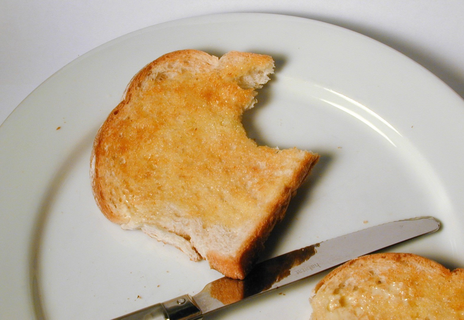 free image of slice of white toast bitten into