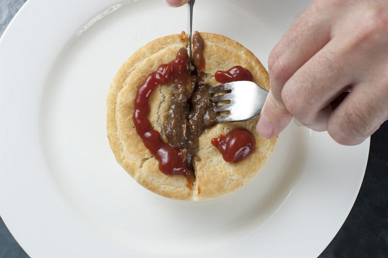 ... Description: Man cutting open a tasty meat pie with a cute gravy