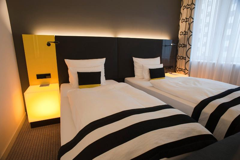 Free Image Of Funky Modern Black And White Bedroom