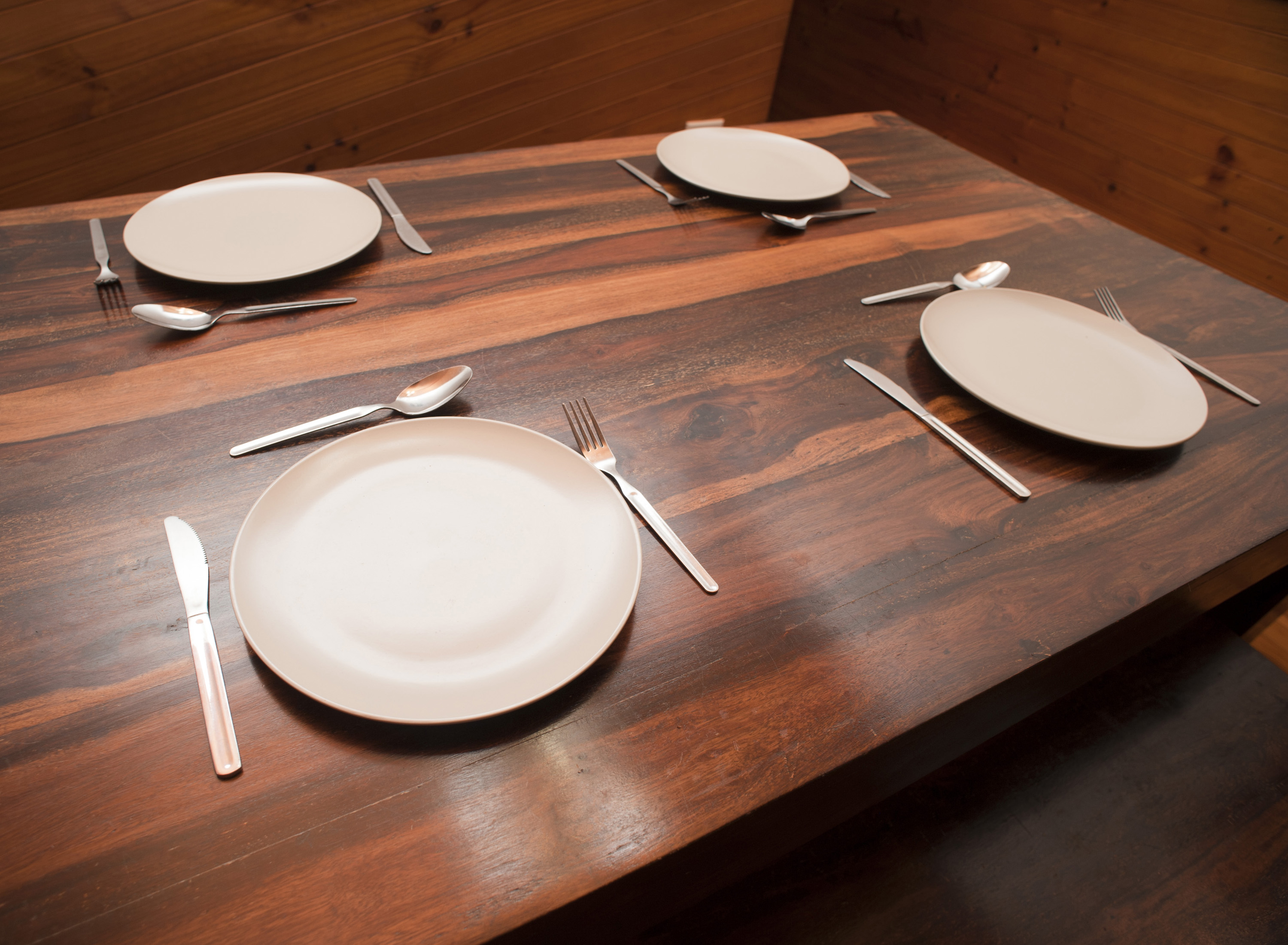 & Free image of Dinner table set with four place settings