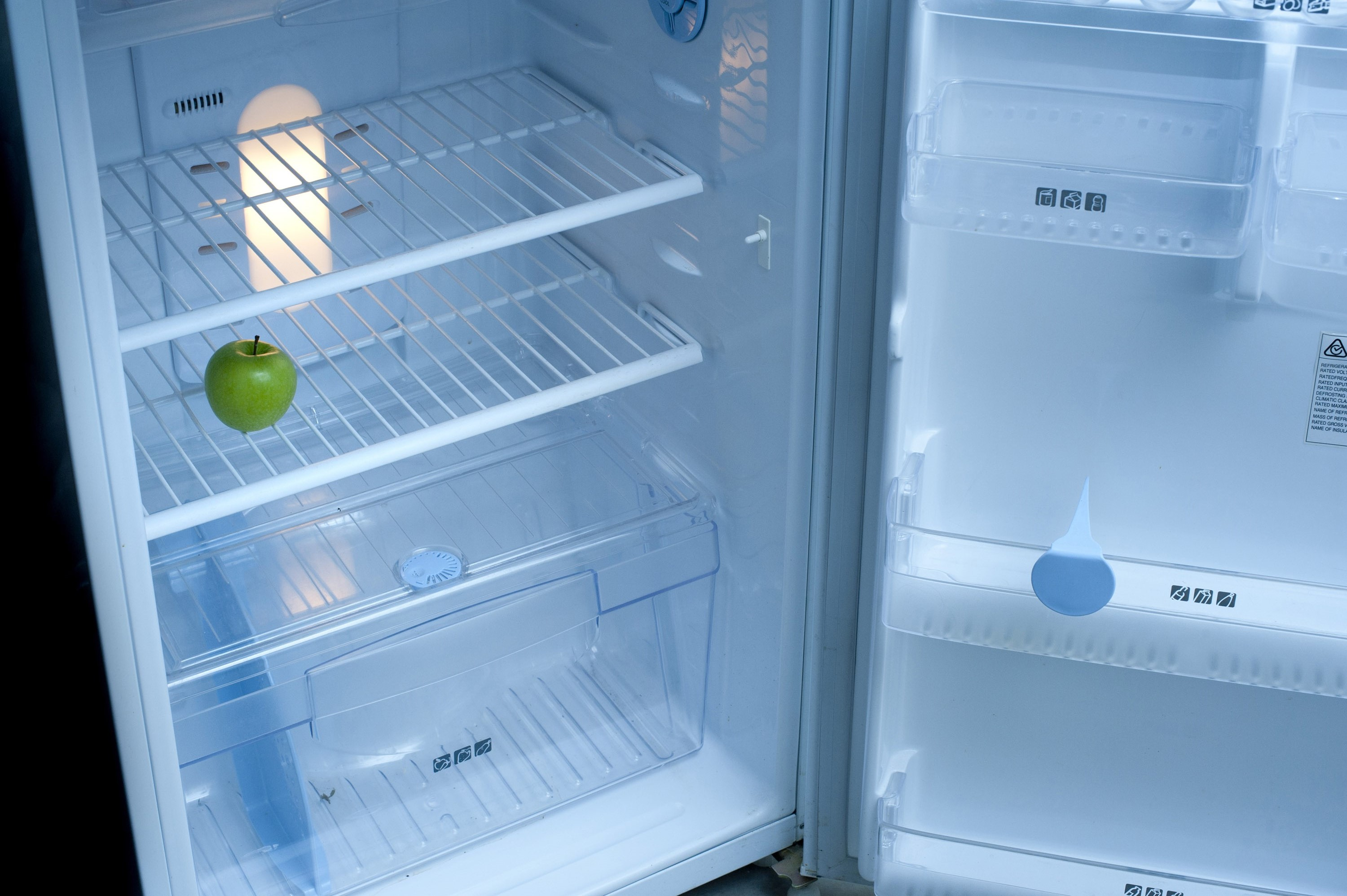 Free image of Only one apple left in the fridge