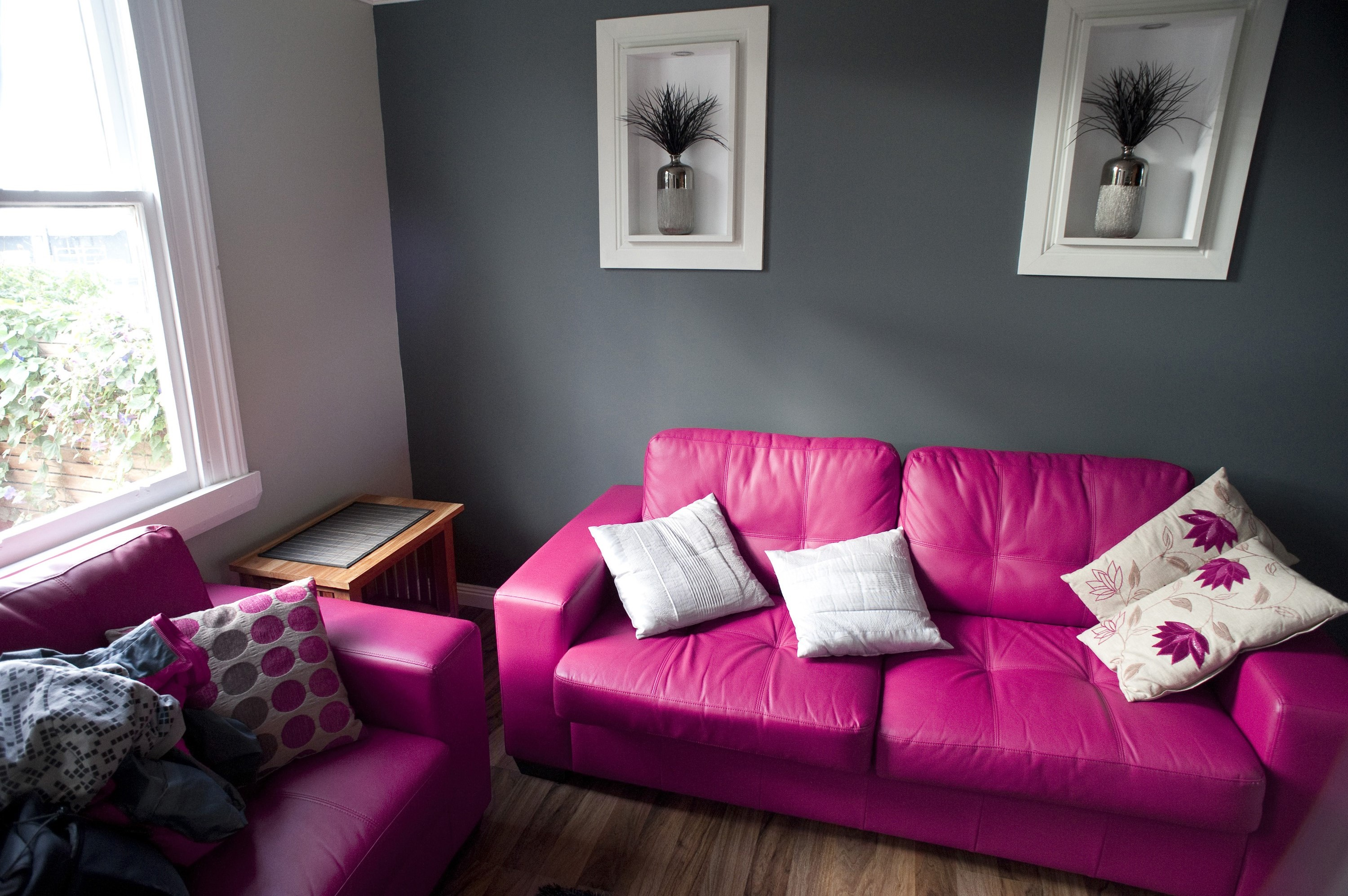 Grey Living Room With Bright Colors free image of pink and grey living room