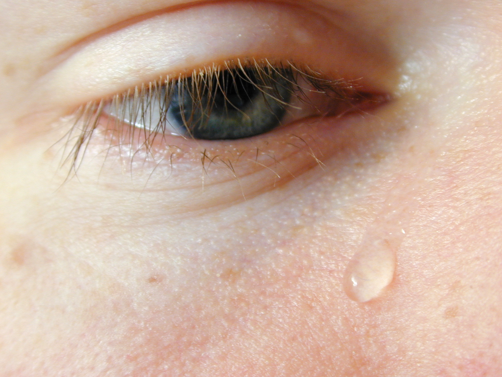 Free Image Of Sad Person Crying With Tear Drop On Cheek