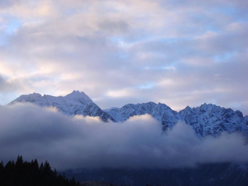 line of clouds cover the remarkables mountain range, newzealand