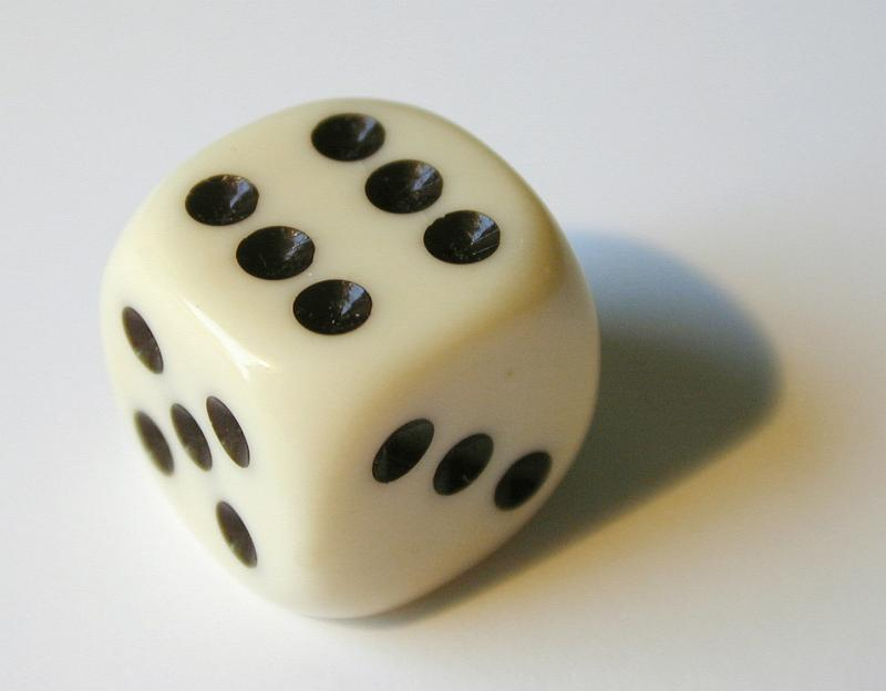 Image Description: a white bone playing dice showing the number 6: www.freeimages.co.uk/galleries/sports/sportsgames/slides/whitedice1...