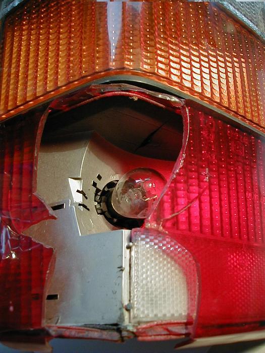 free image of broken red plastic lens on a car light. Black Bedroom Furniture Sets. Home Design Ideas