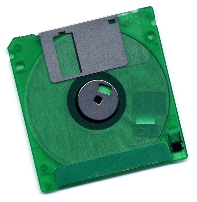 Free image of Old green floppy disk on white