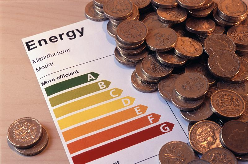 Free Stock Photo: an energy efficiency rating label with a pile of coins, energy saving concept