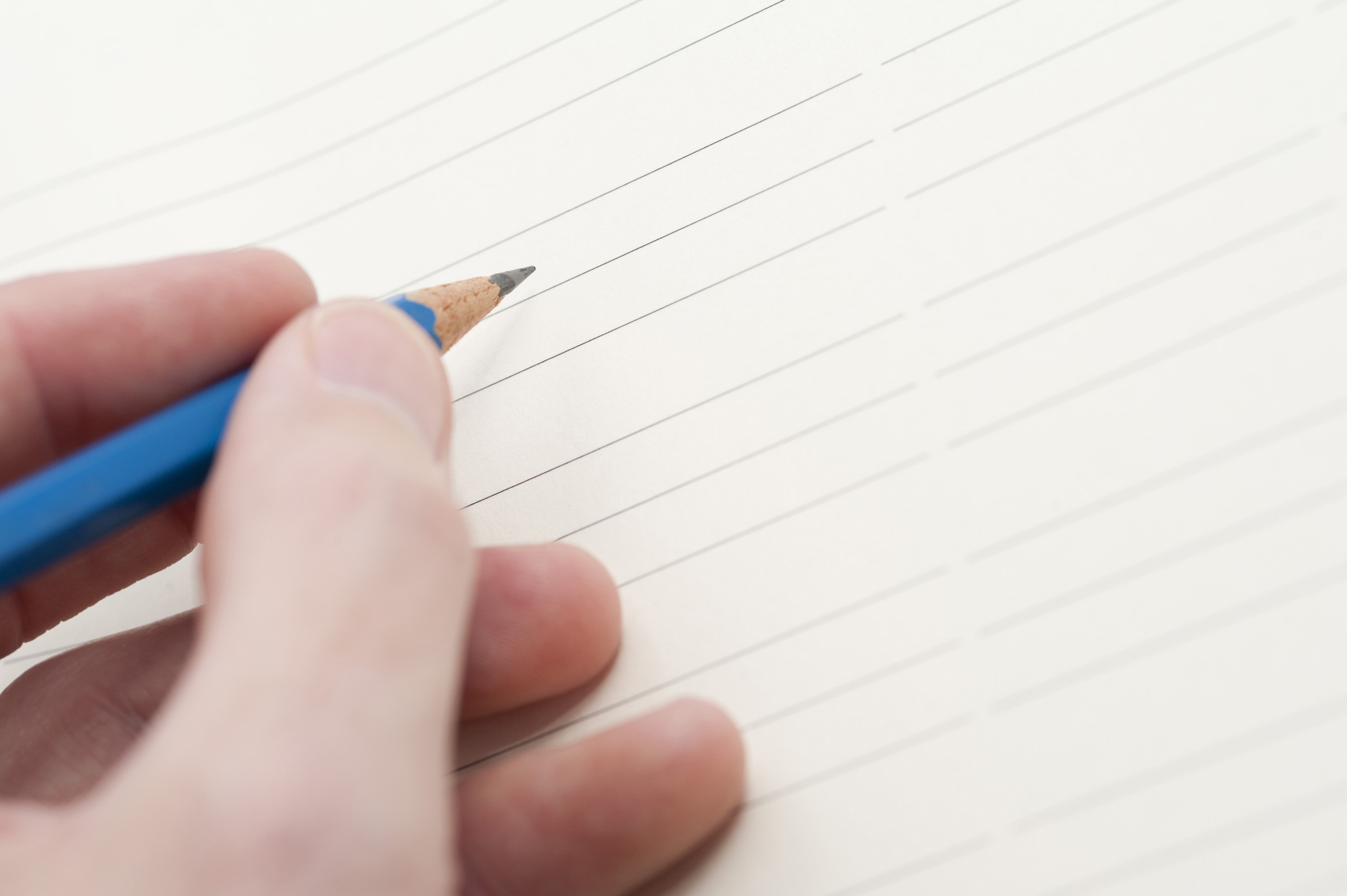 free image of hand holding pencil ready to write