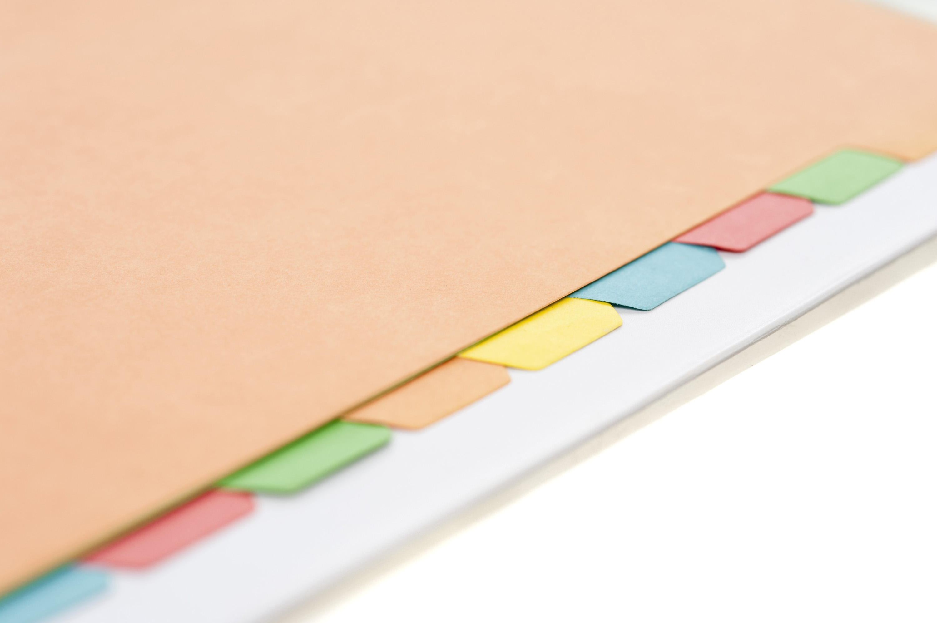 free image of colored index tabs lined up in a manila folder
