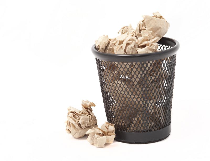Free image of A circular file cabinet or trash can getting full
