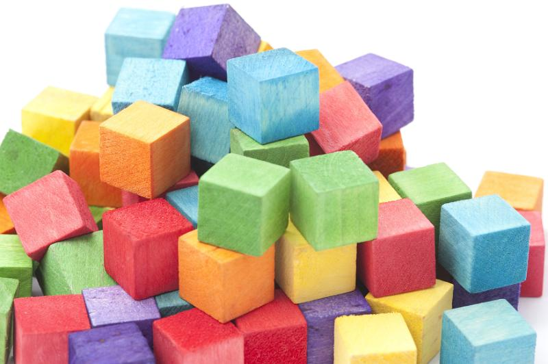 Free image of Jumbled Pile of Multi-Colored Wooden Cube Blocks